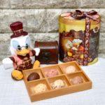 東京ディズニーランド35周年「チョコレートクランチ」スクルージデザイン缶&ぬいぐるみバッジ